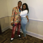 Speed Darlington grabs a female fan's butt as she brought a photograph with him