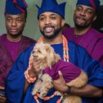 Uncommon photograph of Banky W and his dog at his wedding