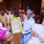 Former 1st ladies, Maryam Abacha & Fati Abdulsalam Abubakar, present President Buhari a birthday card at his surprise get together