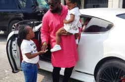 Timaya pictured on a school run with his daughters